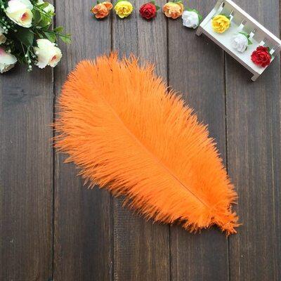 Перья страуса 30-35 см. Оранжевого цвета
