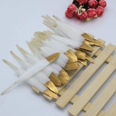 Перья утиные 10-15 см. 20 шт. Бело-золотые
