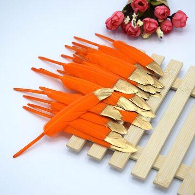 Перья утиные 10-15 см. 20 шт. Оранжевые с золотом