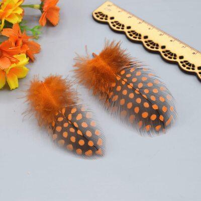 """Перья цесарки """"горох"""" 5-13 см. 10 шт. Оранжевый цвет"""