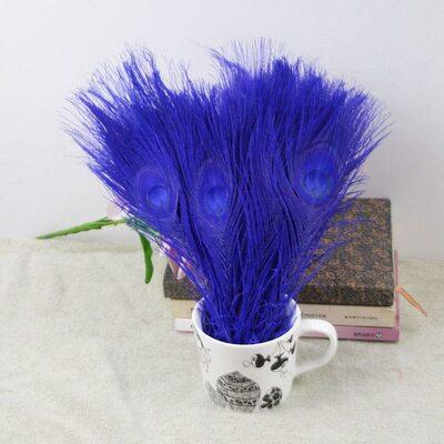 Цветные перья павлина 25-30 см. Синего цвета