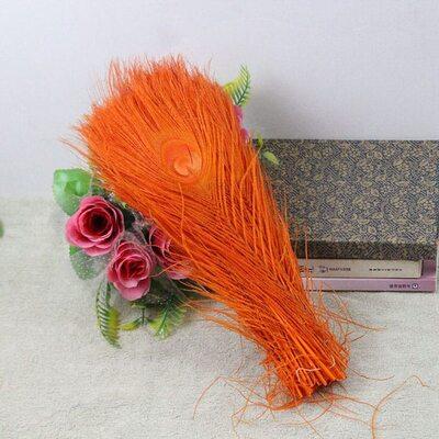 Цветные перья павлина 25-30 см. Оранжевый цвет