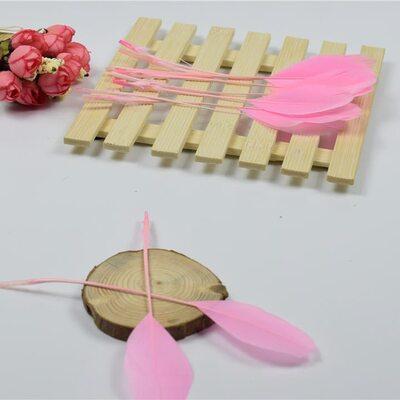 Перья гуся на ножке 13-18 см. 10 шт. Розового цвета