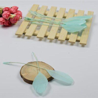 Перья гуся на ножке 13-18 см. 10 шт. Ментолового цвета