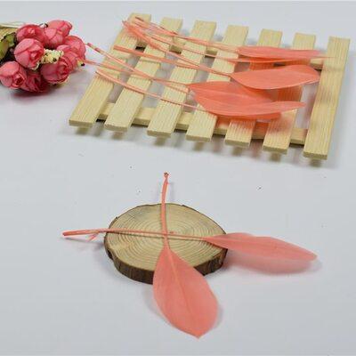 Перья гуся на ножке 13-18 см. 10 шт. Кораллового цвета