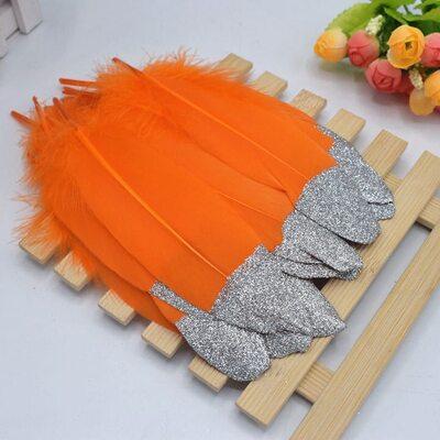 Пушистые перья гуся 15-20 см, 10 шт. Оранжевые с серебрянной крошкой