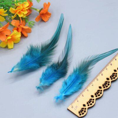 Перья петуха двухцветные 10-15 см. 50 шт. Голубого цвета