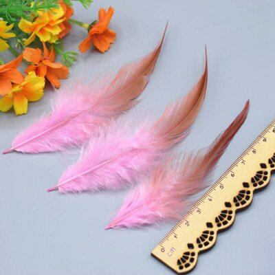 Перья петуха двухцветные 10-15 см. 50 шт. Светло розовый цвет