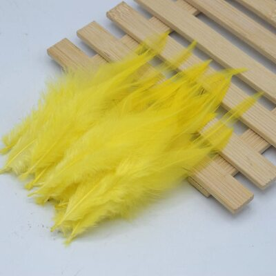 Перья петуха 10-15 см. 20 шт. Желтого цвета