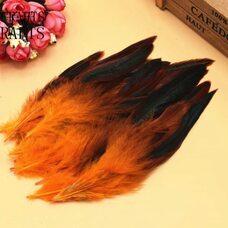 Перья петуха двухцветные 12-18 см. 20 шт. Оранжевого цвета