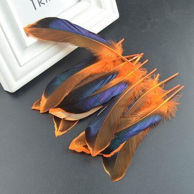 Перья утки 10-15 см. с отливом 10 шт. Оранжевый цвет
